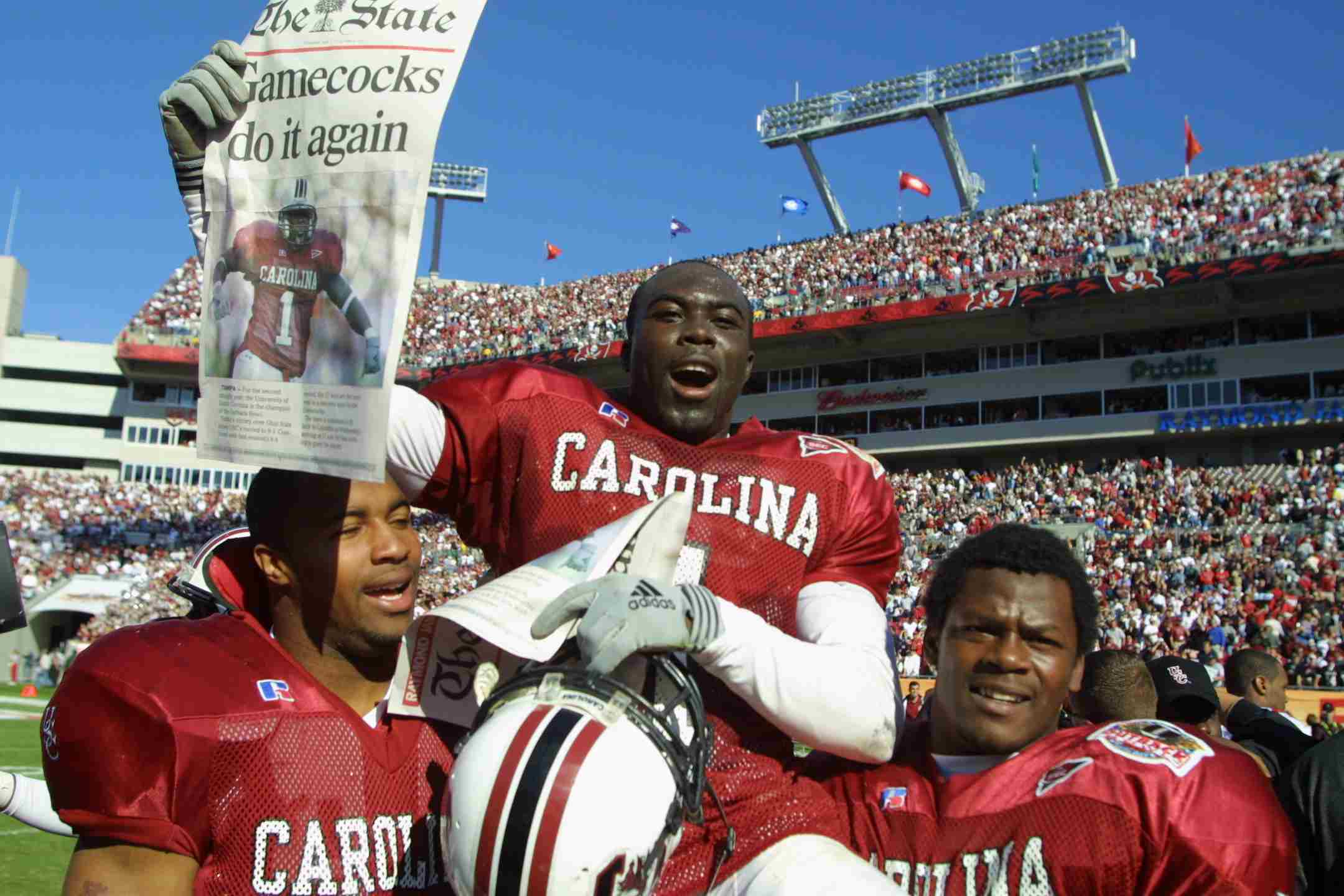 South Carolina player Antoine Nesmith, #1, is carried off the field by teammates after beating Ohio State 31-28 in the Outback Bowl