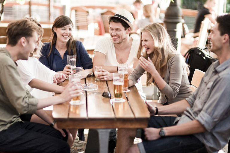 Young people drinking beer outdoors