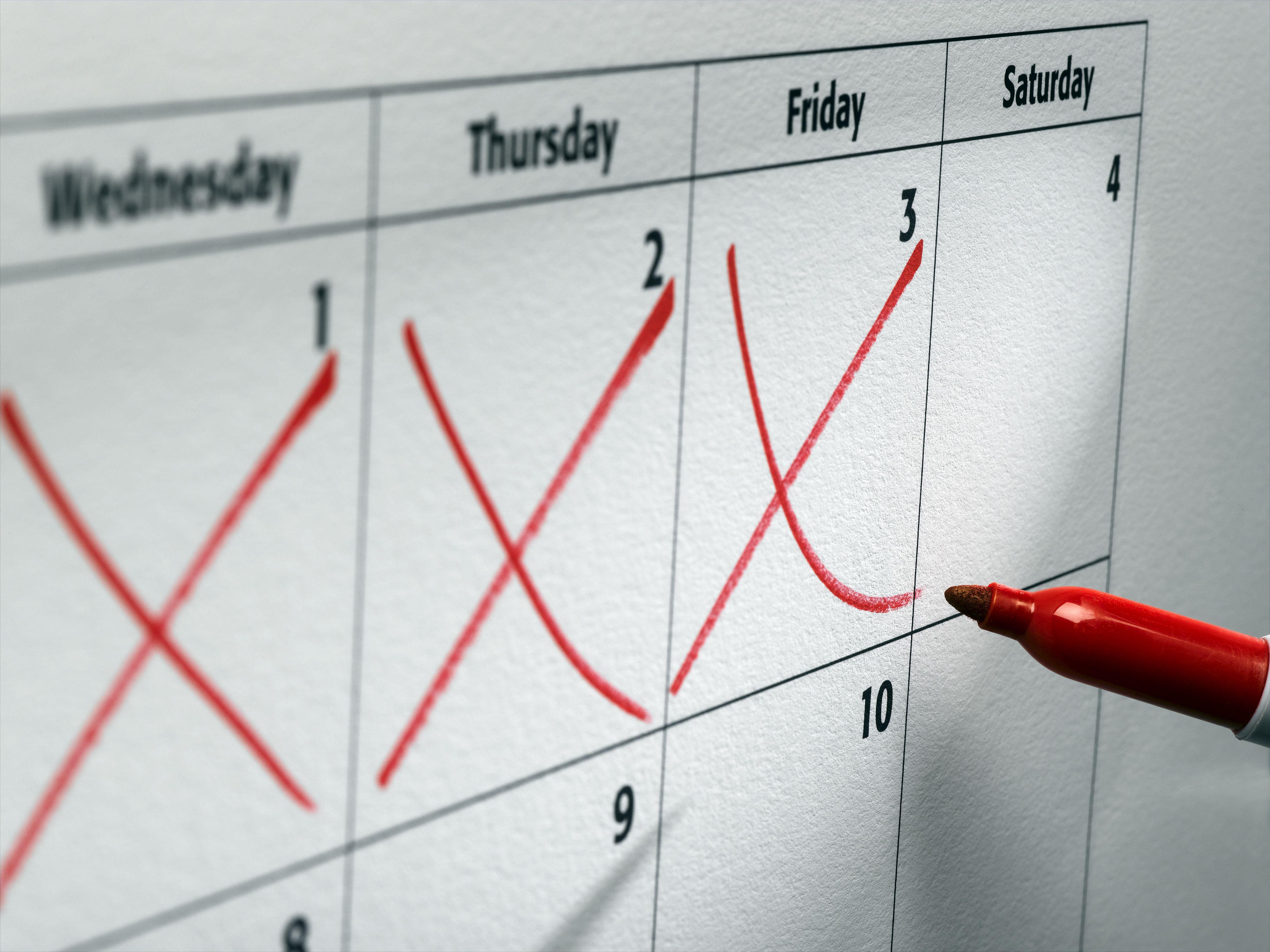 Three days crossed off on wall calendar, close-up