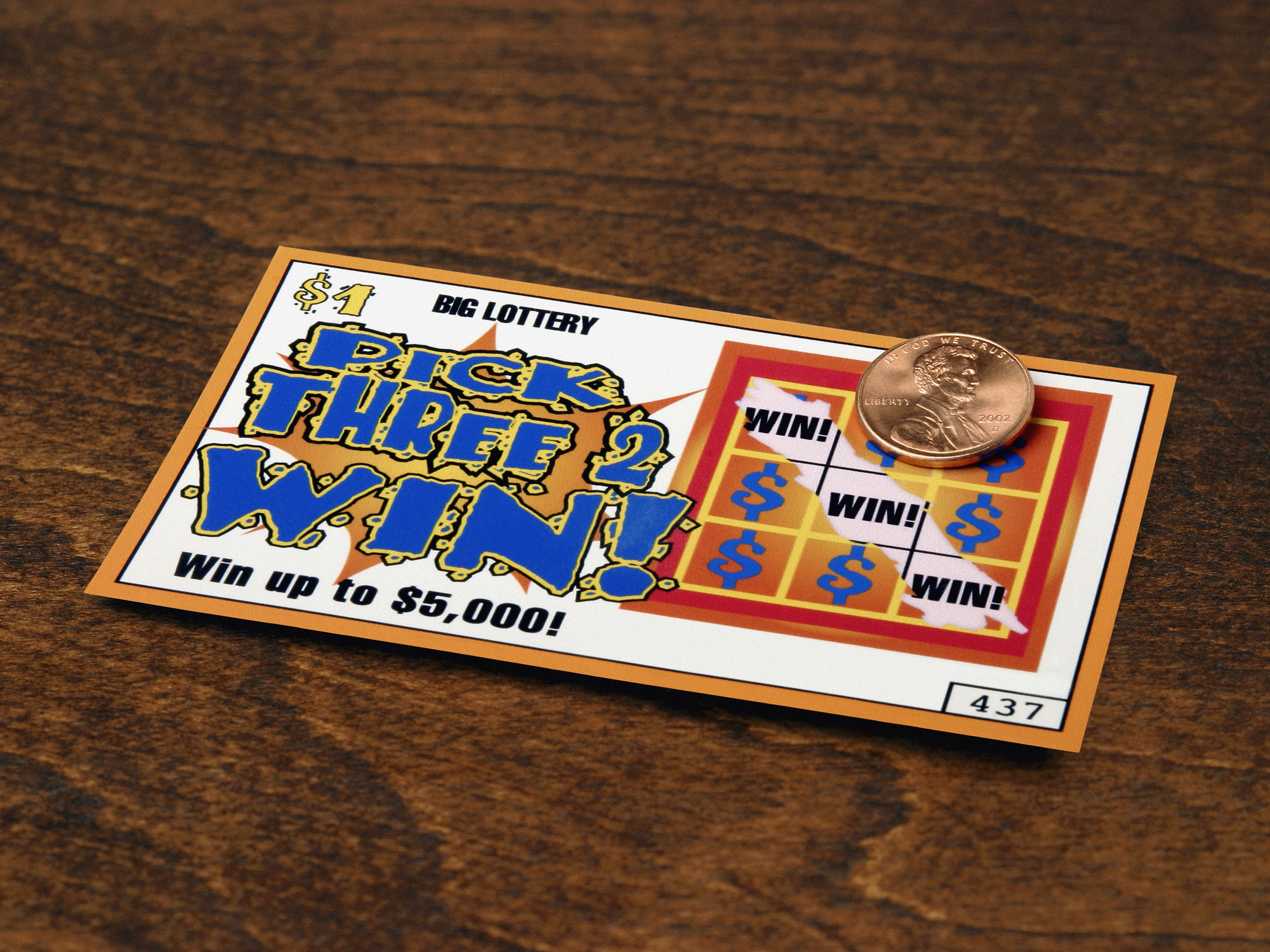 Scratched off lottery ticket exposing winning tick