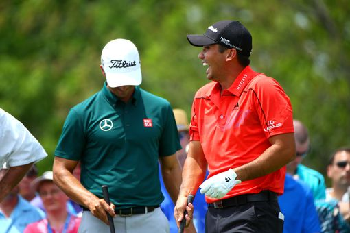 Jason Day shares a laugh with his caddie and fellow golfers at the first hole during the 2014 Memorial Tournament