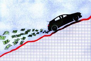 A car driving up a money graph