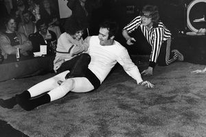 Andy Kaufman wrestling Lena Home with referee watching