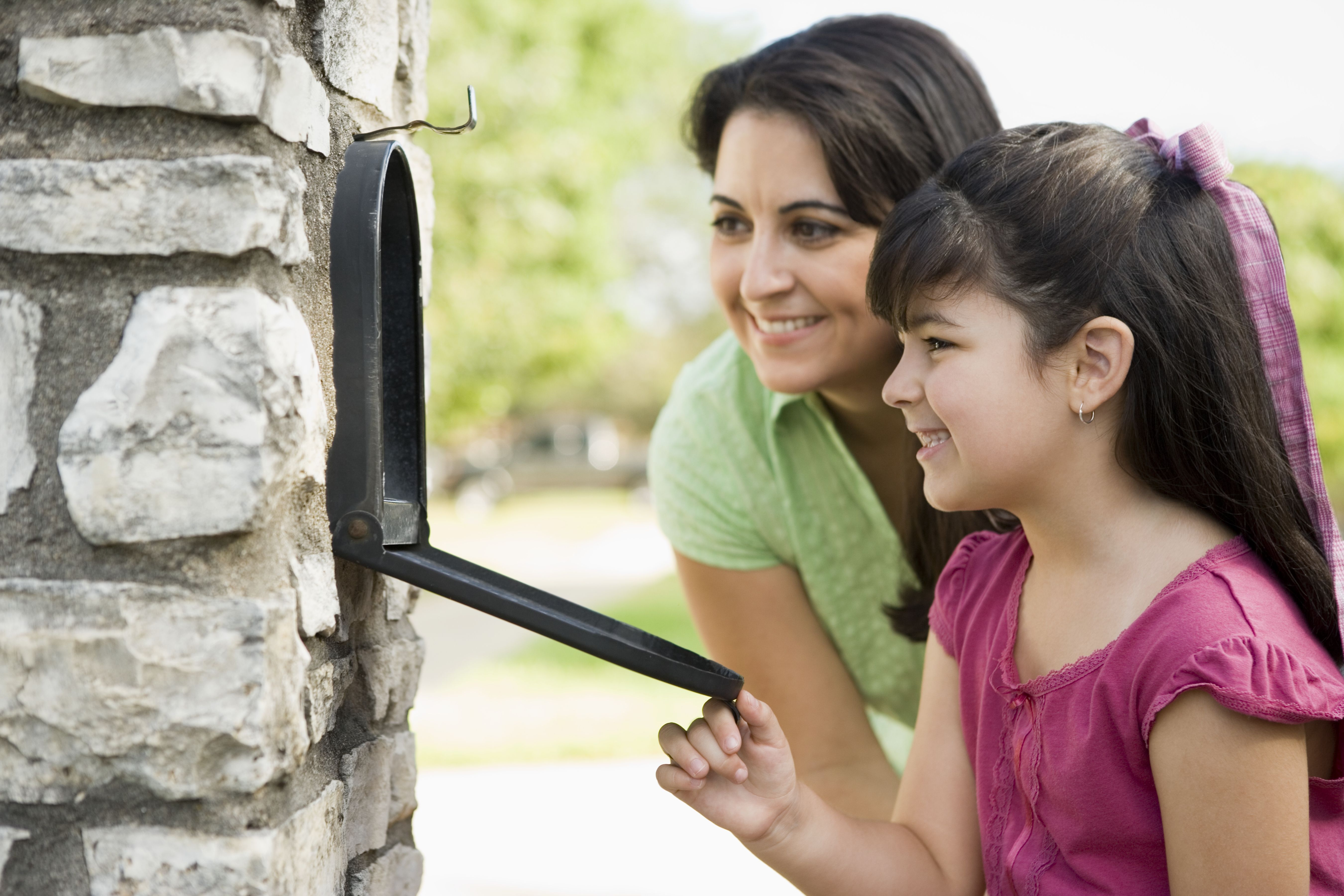 Mother and Daughter Looking into Mailbox