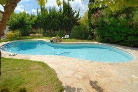 A swimming pool in a Mediterranean garden