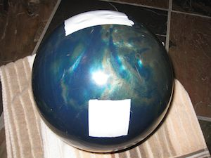 A bowling ball with duct tape over the holes.