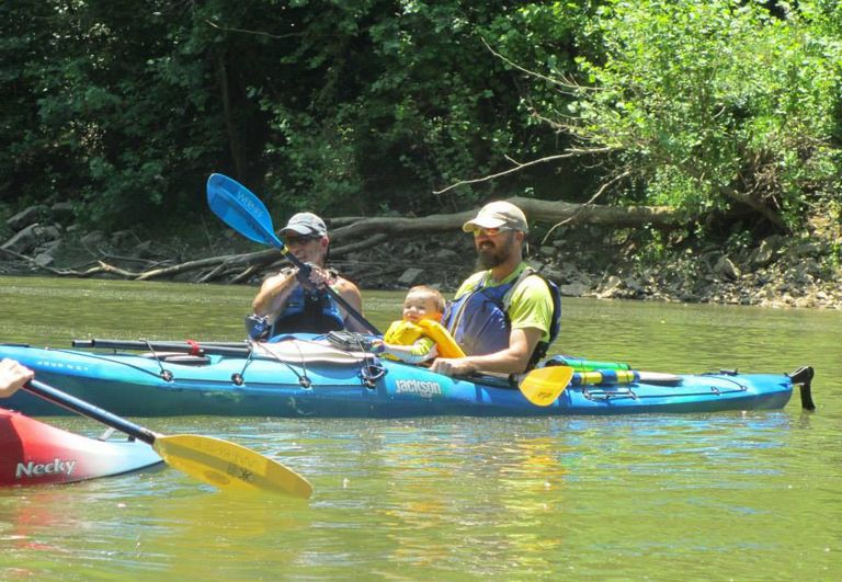 Family canoeing together with a toddler.