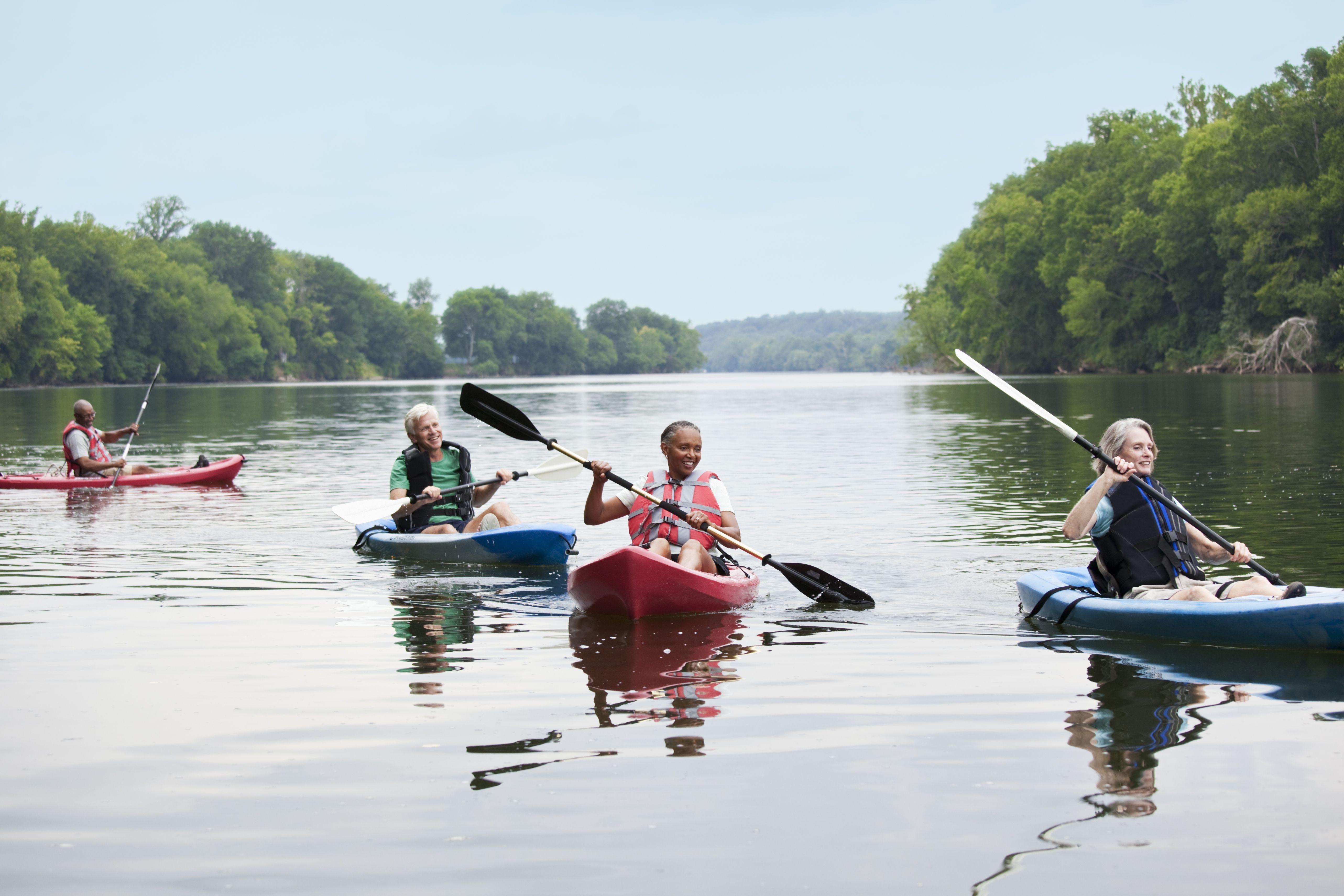 Couples kayaking on river