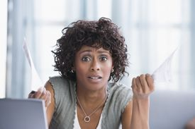 Image of a Woman Confused by Prize Notifications