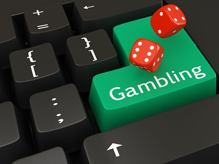 """Image of a Keyboard with the word """"Gambling"""" in green and a pair of rolling dice"""