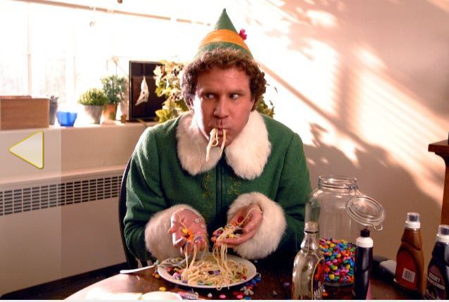Buddy the Elf eating candy on spaghetti