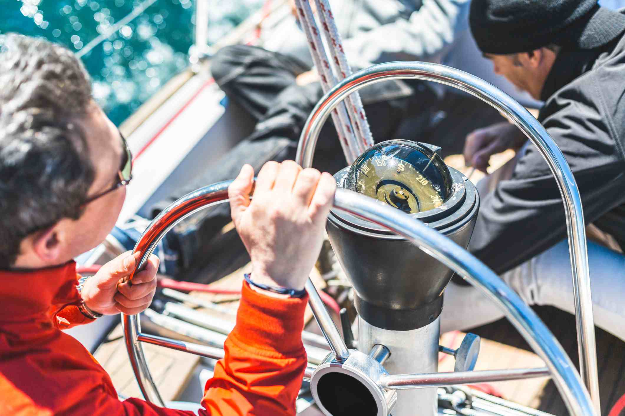 Skipper at the helm of a sailing boat