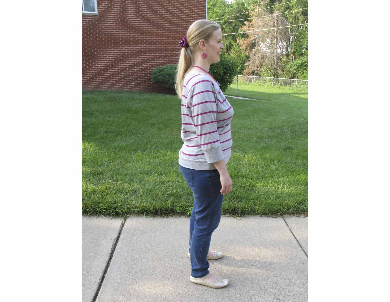 Woman standing on sidewalk with proper posture