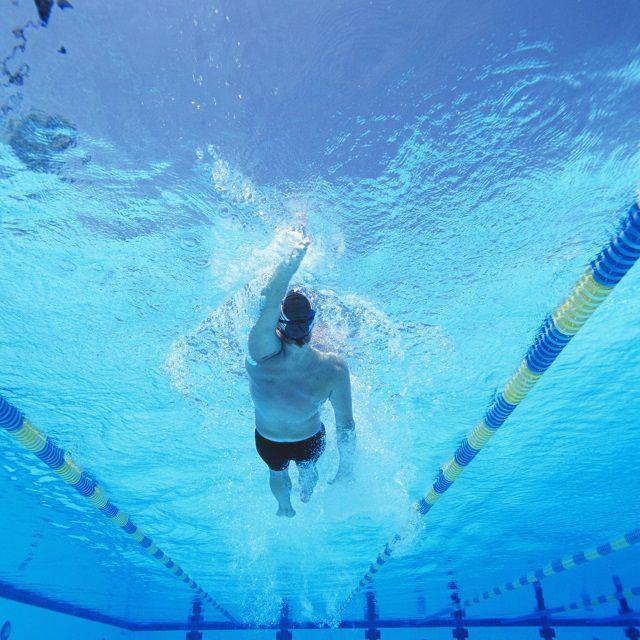 Male swimmer doing backstroke.