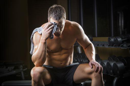 Taking a rest break in the gym.