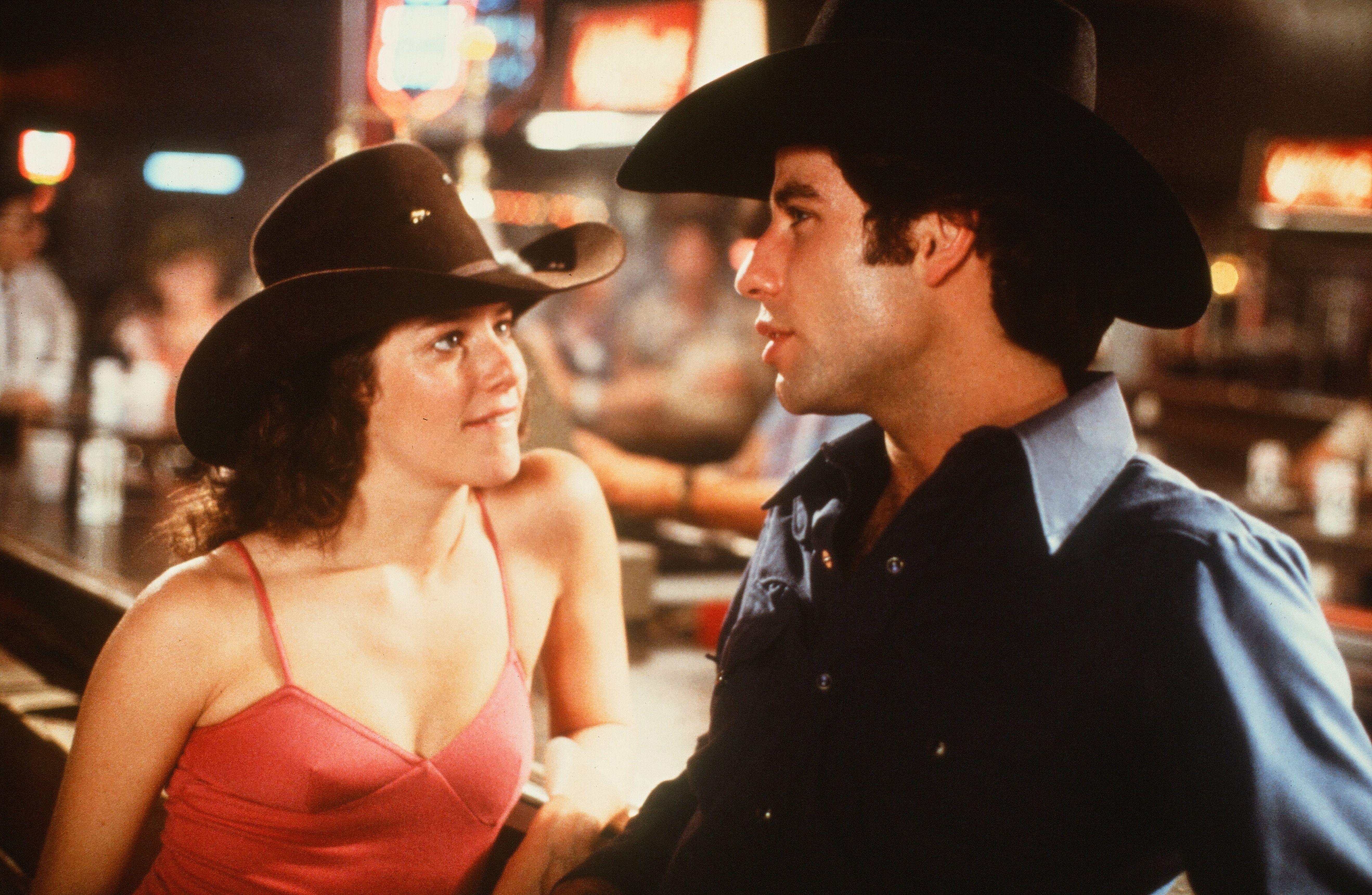 John Travolta and Debra Winger