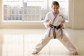 Young girl in karat pose