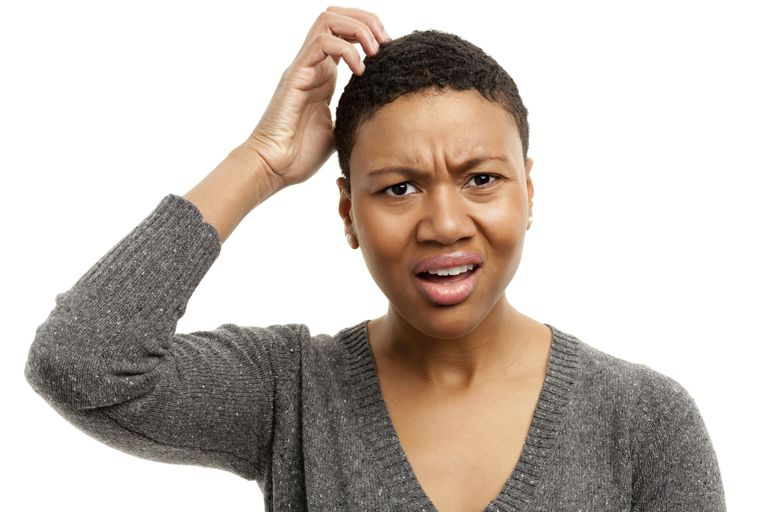 A woman frustrated with her scab hair