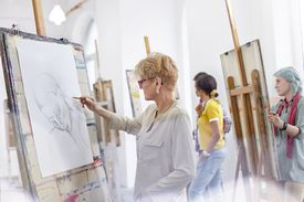 Women drawing in an artists studio