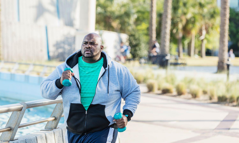 African-American man jogging or power walking