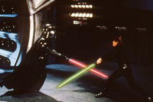 Darth Vader and Luke Skywalker engage in a lightsaber battle in