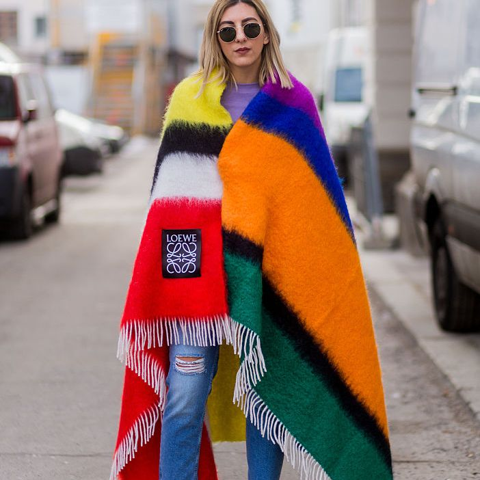 Street style jeans and striped poncho