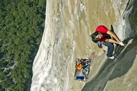 Climbers free climb up the steep face of El Capitan in Yosemite Valley using only their hands and feet to ascend upwards.