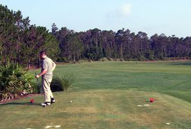 Golfer preparing to play from the red tees