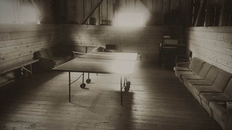 Table Tennis In Illuminated Room