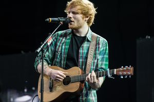 ed sheeran performing with guitar