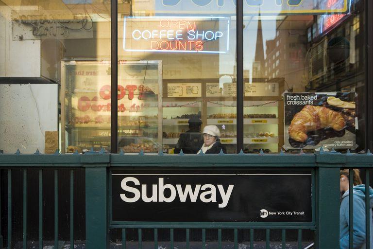 donut shop above subway entrance