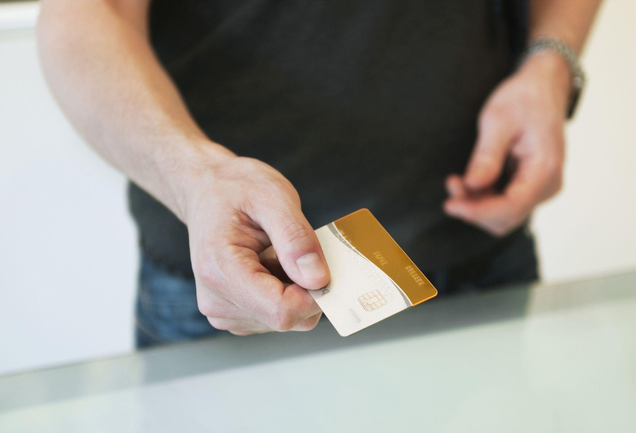 Man Using Credit Card
