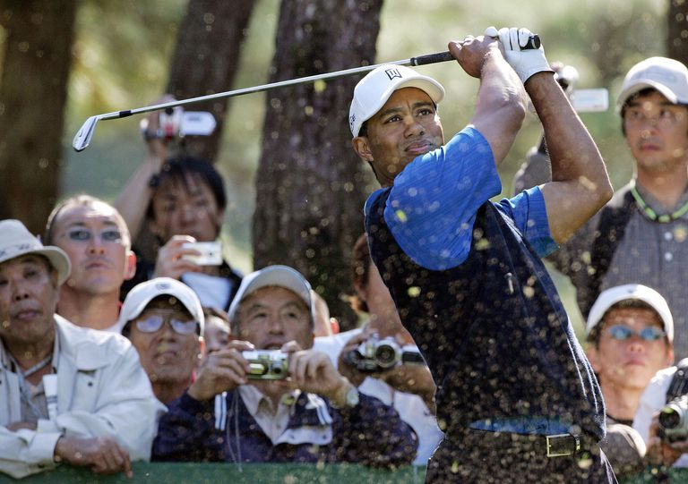 Tiger Woods plays a shot during the Japan Golf Tour's Dunlop Phoenix Tournament in 2006.