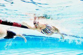 Woman swimming in lane of pool