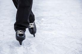 Man skating and training with black skates