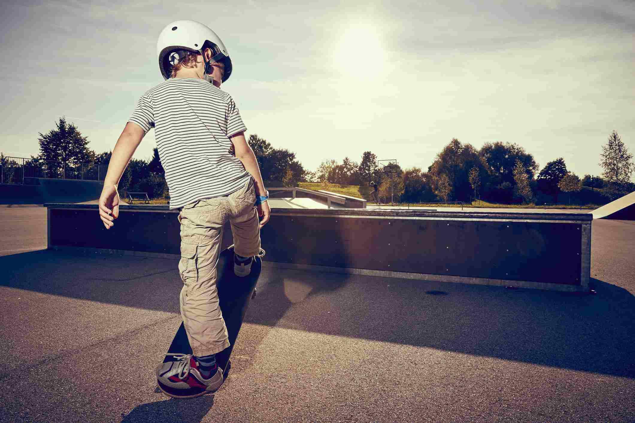 Boy skateboarding in park