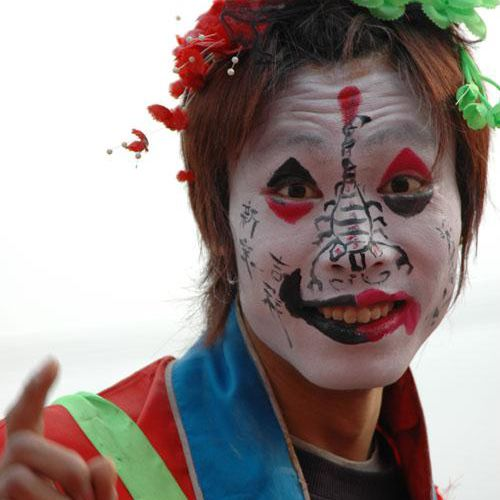 Face Painting Designs -- Man on Stilts, Photographed in China