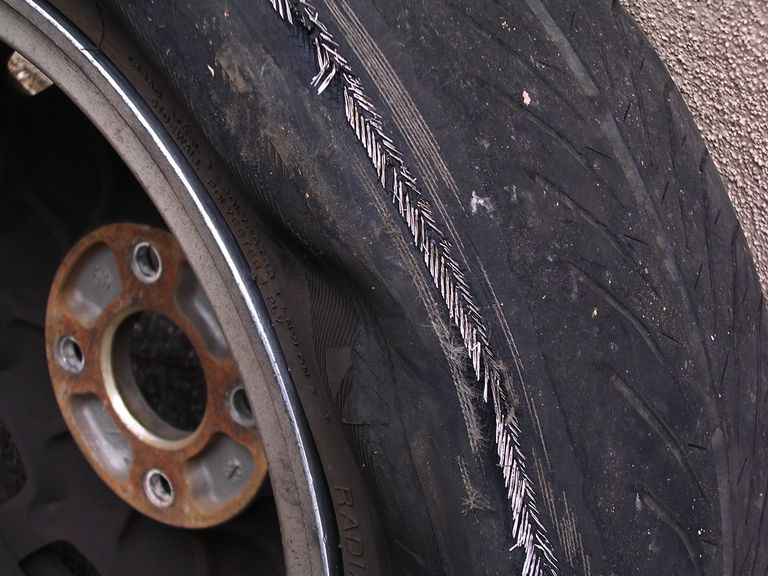 Detail of blown tire, showing exposed steel belts and carcass