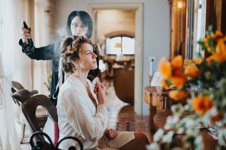Woman getting her hair done before a wedding