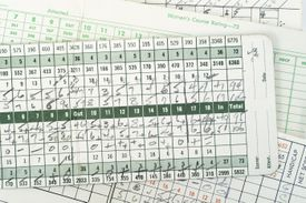 A golf scorecard with out appearing after Hole 9 and in after Hole 18.