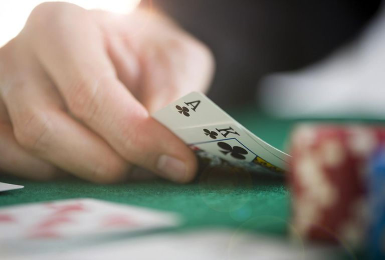 Close-up of man showing poker hand, close-up