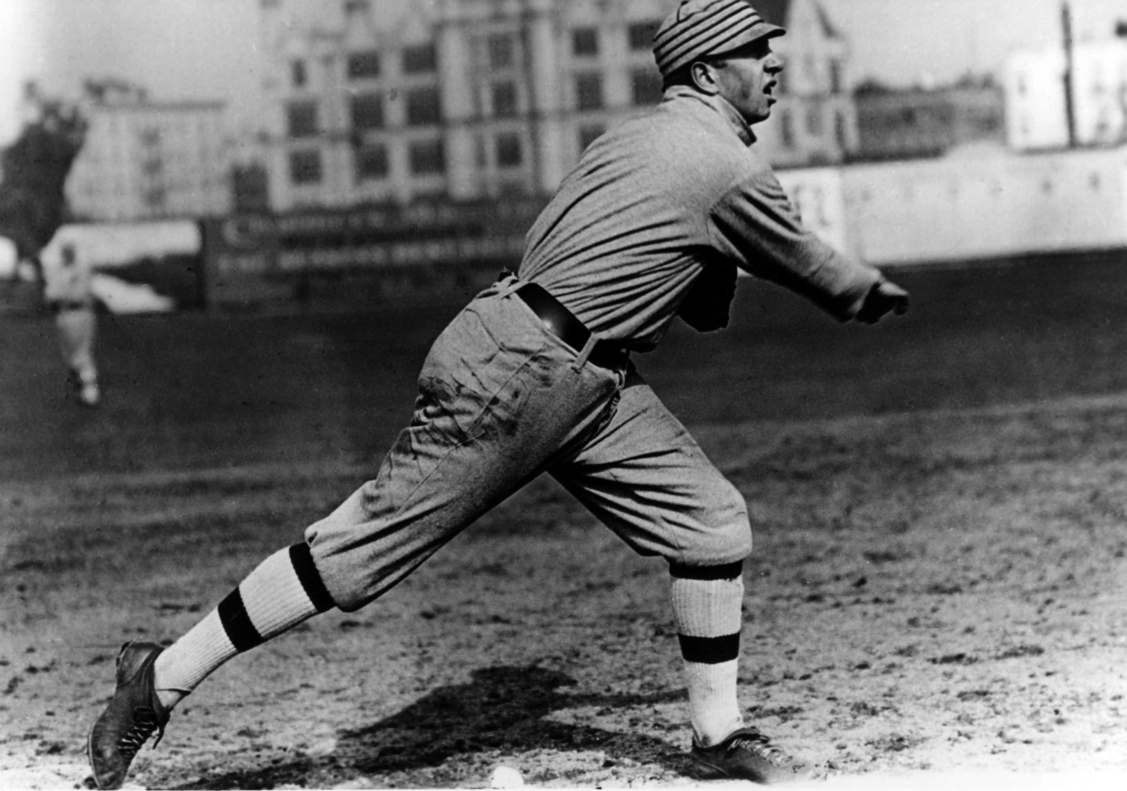 LATE 1920'S: Philadelphia Athletics player Eddie Collins following through on a throw.