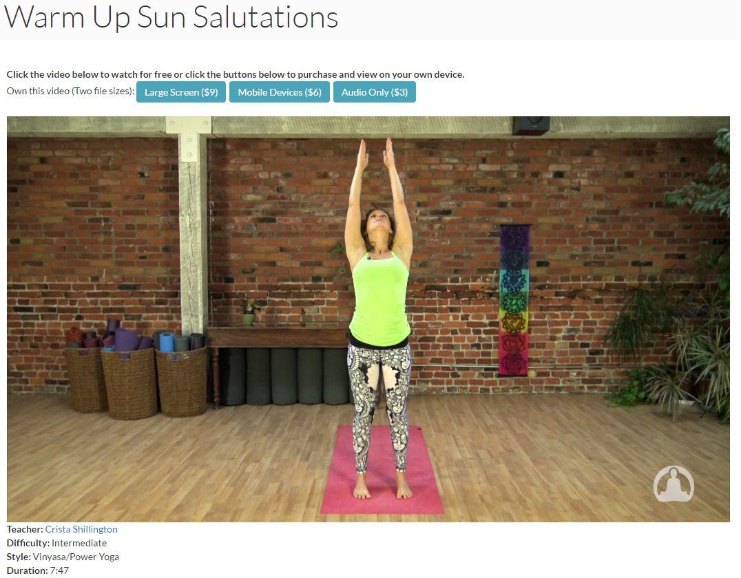 A woman doing a sun salutation