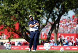 Patrick Reed of the United States hits off the 12th tee and yells fore
