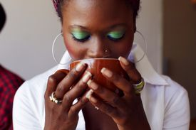 Woman drinking out of coffee mug
