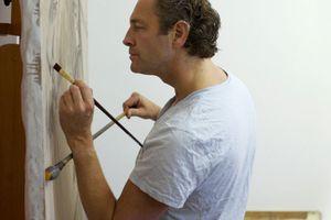 Artist using a mahl stick