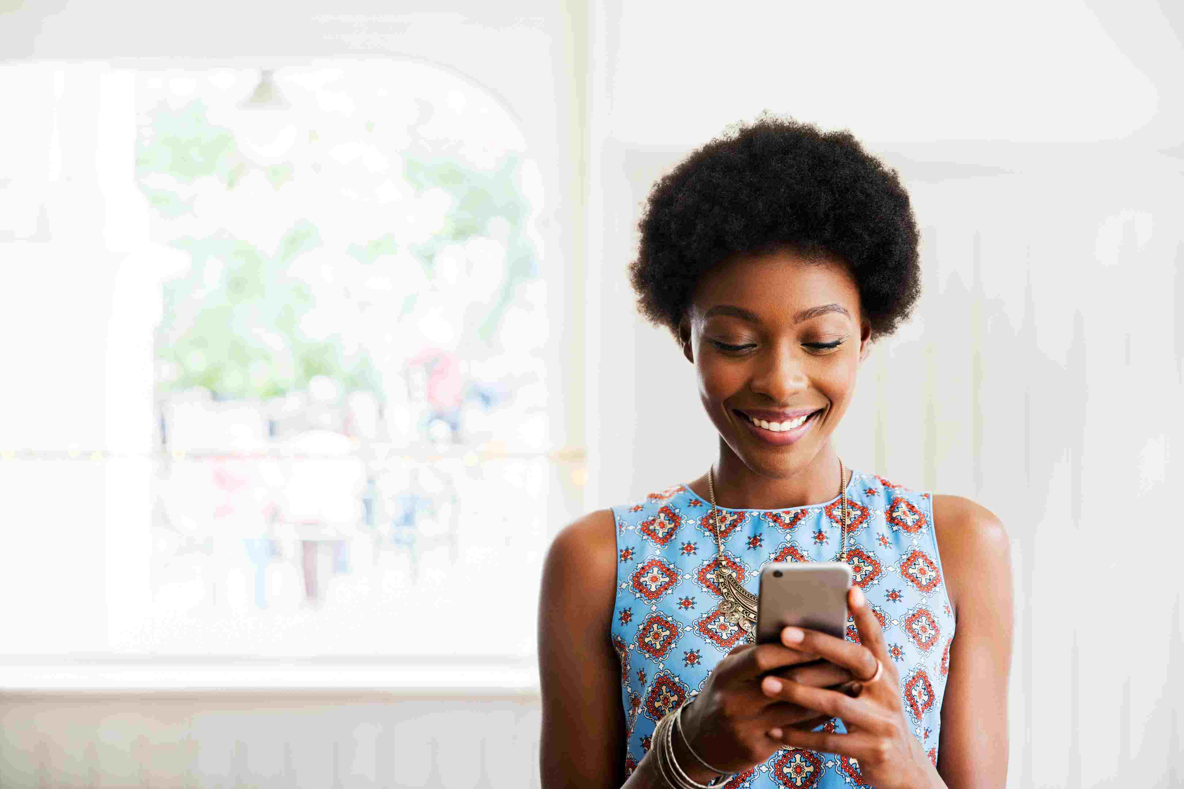 Woman smiling using smart phone