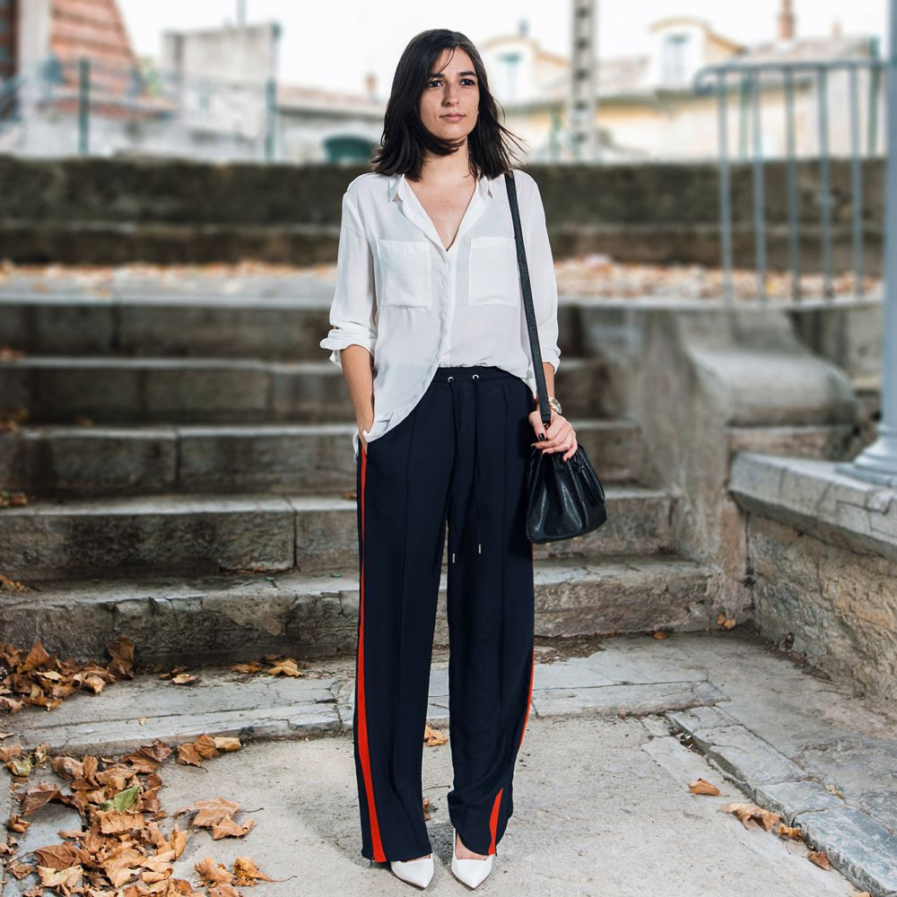 Woman in track pants and blouse