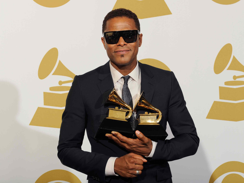 Maxwell holding Grammy awards
