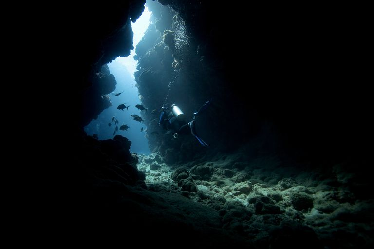 Scuba Diver in underwater cavern.